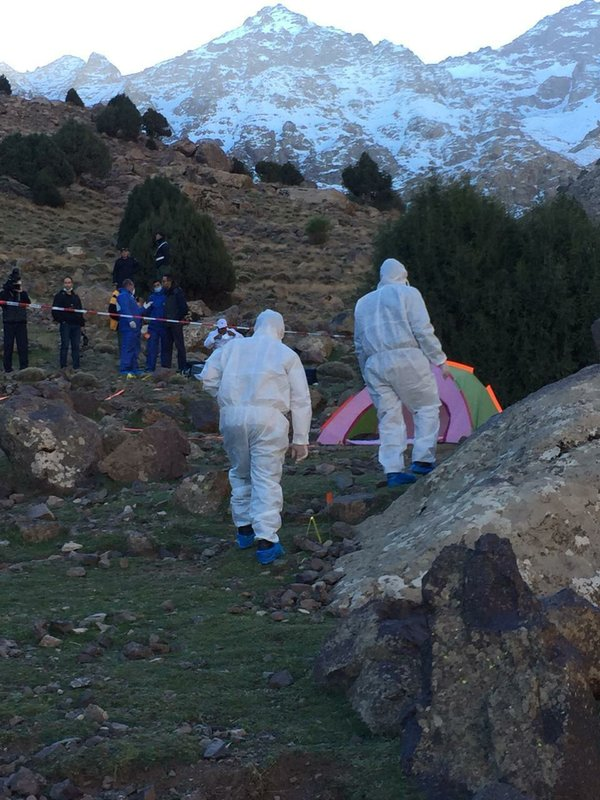 In this photo provided by Moroccan news channel 2M and taken on Tuesday, Dec. 18, 2018, a forensic team is seen at the area where the bodies of two Scandinavian women tourists were found dead, near Imlil in the High Atlas mountains, Morocco. (2M via AP)