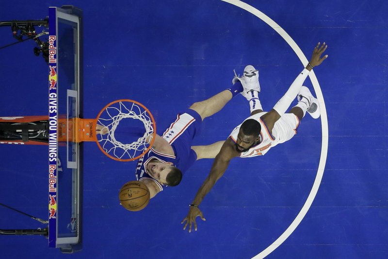 Philadelphia 76ers' Mike Muscala, left, goes up for a shot against New York Knicks' Tim Hardaway Jr. during the first half of an NBA basketball game, Wednesday, Dec. (AP Photo/Matt Slocum)