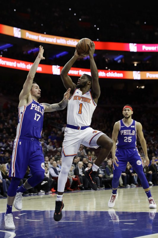 New York Knicks' Emmanuel Mudiay (1) goes up for a shot against Philadelphia 76ers' JJ Redick (17) during the first half of an NBA basketball game, Wednesday, Dec. (AP Photo/Matt Slocum)