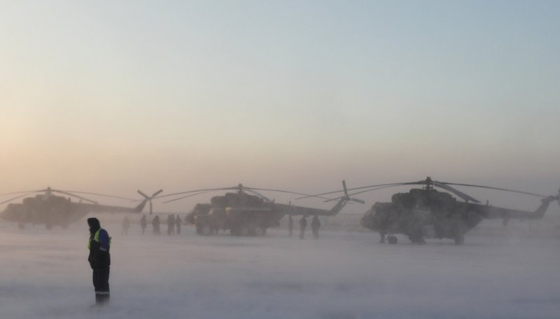 Search and rescue helicopters are seen before a flight to the landing area of the Soyuz MS-09 capsule with the International Space Station (ISS) crew onboard during sunrise in the town of Zhezkazgan, formerly known as Dzhezkazgan, Kazakhstan, Thursday, Dec. (Shamil Zhumatov/Pool Photo via AP)