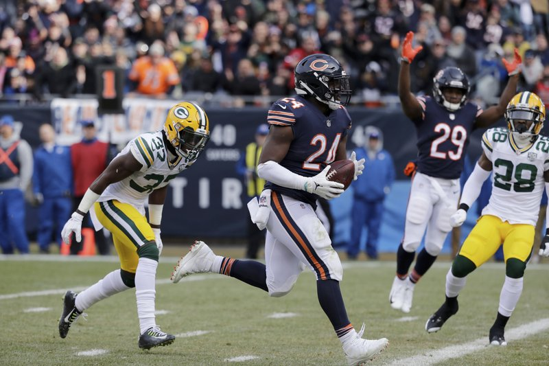 FILE - In this Sunday, Dec. 16, 2018 file photo, Chicago Bears running back Jordan Howard (24) runs to the end zone for a touchdown during the first half of an NFL football game against the Green Bay Packers in Chicago. (10-4) already won the NFC North to complete a worst-to-first turnaround and the Houston Texans (10-4) are on the verge of securing the AFC South to become the second team to do it this season. (AP Photo/Nam Y. Huh, File)