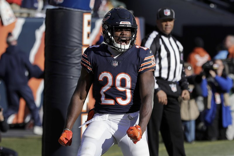 FILE - In this Sunday, Dec. 16, 2018 file photo, Chicago Bears running back Tarik Cohen (29) celebrates a touchdown during the first half of an NFL football game against the Green Bay Packers in Chicago. (10-4) already won the NFC North to complete a worst-to-first turnaround and the Houston Texans (10-4) are on the verge of securing the AFC South to become the second team to do it this season. (AP Photo/Nam Y. Huh, File)