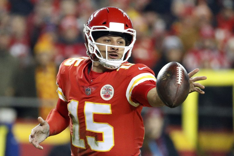 FILE - In this Dec. 13, 2018 file photo Kansas City Chiefs quarterback Patrick Mahomes (15) flips the ball during the first half of an NFL football game against the Los Angeles Chargers in Kansas City, Mo. (AP Photo/Charlie Riedel, File)