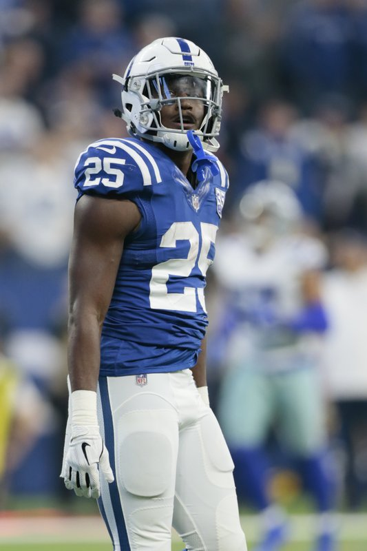 FILE - In this Sunday, Dec. 16, 2018 file photo, Indianapolis Colts running back Marlon Mack looks up at the scoreboard after scoring a touchdown during the first half of an NFL football game against the Dallas Cowboys, in Indianapolis. (AP Photo/AJ Mast, File)