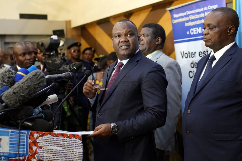 Corneille Nangaa, the president of the independent electoral commission (CENI), announces that the elections will be postponed, in Kinshasa, Democratic Republic of the Congo, Thursday Dec. (AP Photo/Jerome Delay)