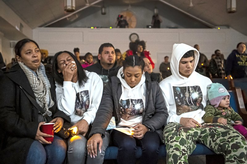 Family members react as Courtney Angelo, a fourth grade teacher who taught some of the children who were killed, speaks during a prayer vigil for the five children killed Dec. (Alexandra Wimley/Pittsburgh Post-Gazette via AP)