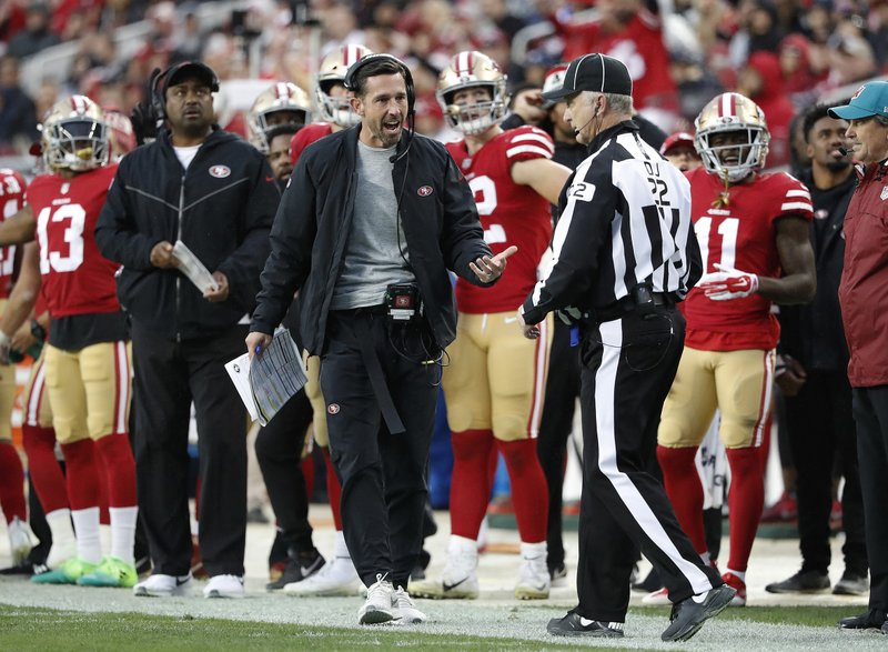 FILE - In this Sunday, Dec. 16, 2018, file photo, San Francisco 49ers head coach Kyle Shanahan talks with an official during the second half of an NFL football game against the Seattle Seahawks in Santa Clara, Calif. (AP Photo/Tony Avelar, File)