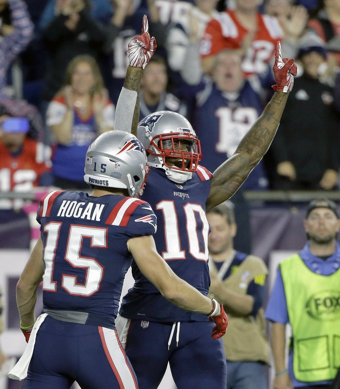 FILE - In this Oct. 4, 2018, file photo, New England Patriots wide receiver Josh Gordon (10) celebrates his touchdown catch with Chris Hogan (15) during the second half of an NFL football game against the Indianapolis Colts, in Foxborough, Mass. (AP Photo/Steven Senne, File)