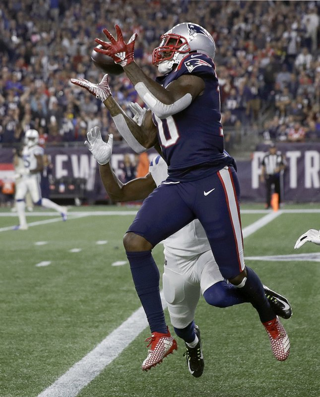 FILE - In this Oct. 4, 2018, file photo, New England Patriots wide receiver Josh Gordon, left, catches a touchdown pass in front of an Indianapolis Colts defender during the second half of an NFL football game, in Foxborough, Mass. (AP Photo/Charles Krupa, File)