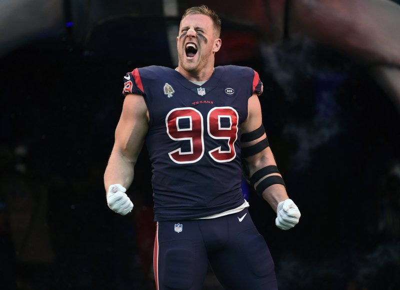 FILE - In this Dec. 2, 2018, file photo, Houston Texans defensive end J.J. Watt (99) yeslls before an NFL football game against the Cleveland Browns,n Houston. (AP Photo/Eric Christian Smith, File)