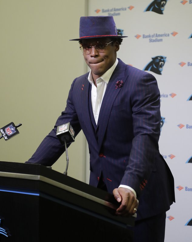 FILE - In this Dec. 18, 2018, file photo, Carolina Panthers' Cam Newton speaks to the media after an NFL football game against the New Orleans Saints, in Charlotte, N. (5-9) at Carolina (6-8). No Cam Newton here thanks to a bad shoulder that has hampered his throwing; Taylor Heinicke makes his first career start. (AP Photo/Chuck Burton, File)