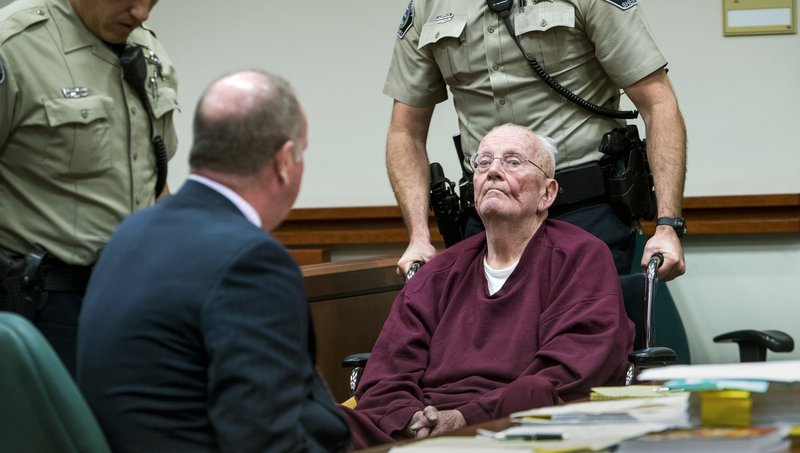 Father William Thomas Faucher is wheeled from the courtroom being sentenced to 25 years in prison without parole Thursday, Dec. (Darin Oswald/Idaho Statesman via AP)