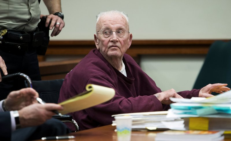 Father William Thomas Faucher waits to be wheeled back to prison after being sentenced to 25 years in prison without parole Thursday, Dec. (Darin Oswald/Idaho Statesman via AP)