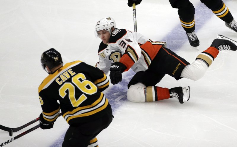 Anaheim Ducks right wing Jakob Silfverberg (33) competes with Boston Bruins center Colby Cave (26) for the puck in the first period of an NHL hockey game, Thursday, Dec. (AP Photo/Elise Amendola)