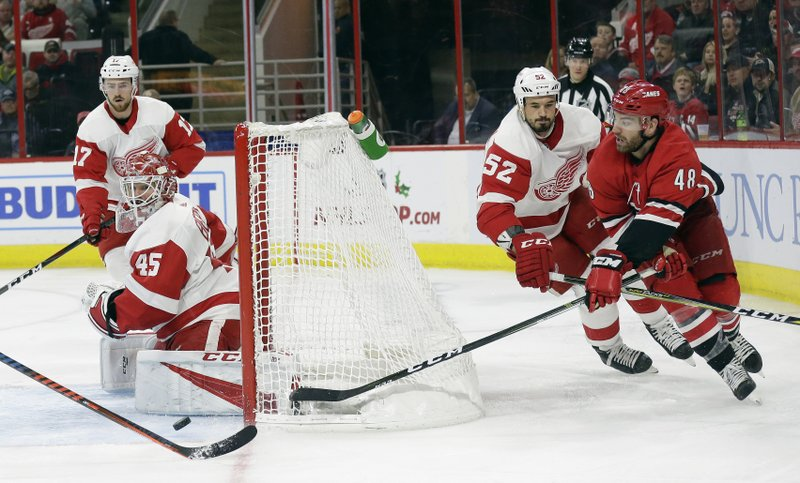 Detroit Red Wings goalie Jonathan Bernier and Jonathan Ericsson (52), of Sweden, defend the goal against Carolina Hurricanes' Jordan Martinook (48) during the second period of an NHL hockey game in Raleigh, N. (AP Photo/Gerry Broome)