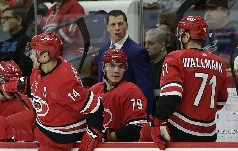 Carolina Hurricanes coach Rod Brind'Amour looks on during the first period of an NHL hockey game against the Detroit Red Wings in Raleigh, N. (AP Photo/Gerry Broome)