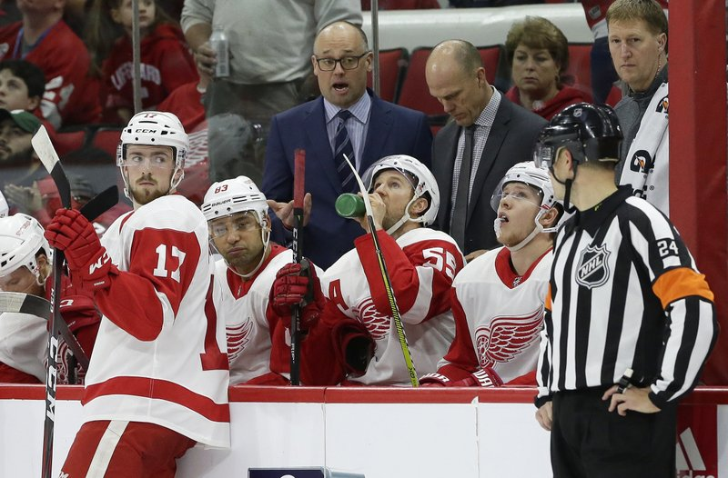 Detroit Red Wings coach Jeff Blashill speaks with an official during the second period of an NHL hockey game against the Carolina Hurricanes in Raleigh, N. (AP Photo/Gerry Broome)