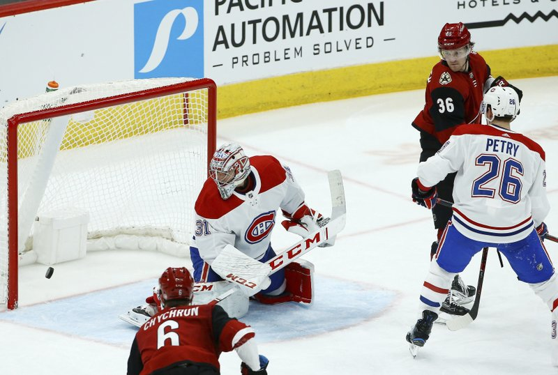 Montreal Canadiens goaltender Carey Price (31) gives up a goal to Arizona Coyotes' Oliver Ekman-Larsson as Coyotes defenseman Jakob Chychrun (6), Coyotes right wing Christian Fischer (36), and Canadiens defenseman Jeff Petry (26) all look on during the second period of an NHL hockey game Thursday, Dec. (AP Photo/Ross D. Franklin)