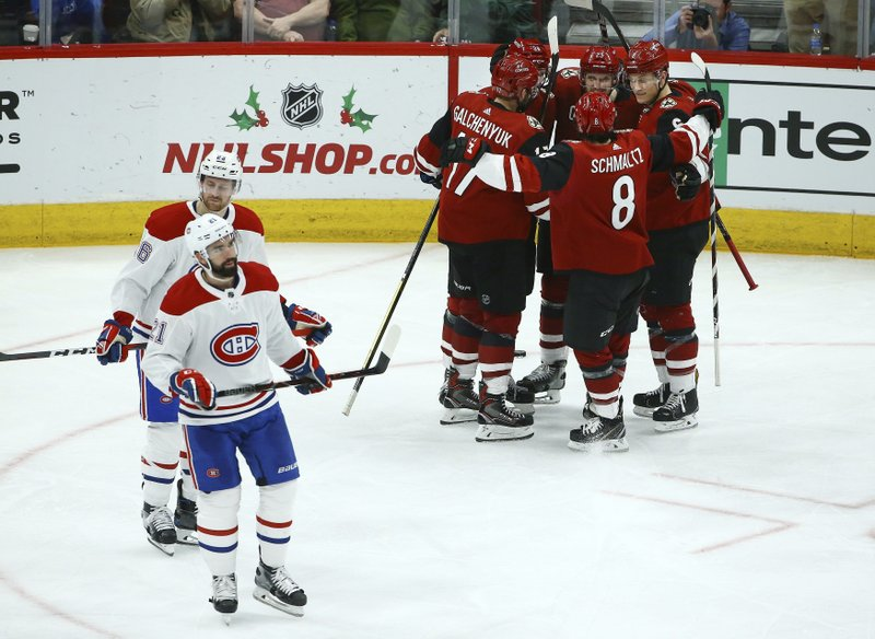Arizona Coyotes defenseman Oliver Ekman-Larsson (23) celebrates his goal with Coyotes center Alex Galchenyuk (17), right wing Christian Fischer (36), center Nick Schmaltz (8) and defenseman Jakob Chychrun (6) as Montreal Canadiens defensemen David Schlemko (21) and Jeff Petry (26) skate past during the second period of an NHL hockey game Thursday, Dec. (AP Photo/Ross D. Franklin)