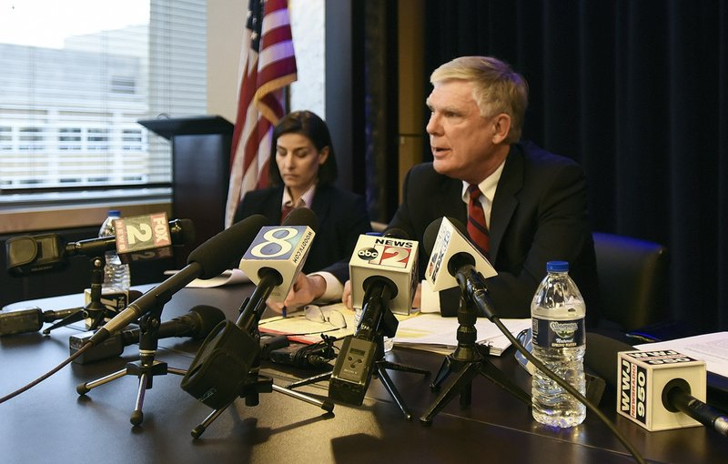 Special counsel Bill Forsyth, right, answers questions, Friday, Dec. 21, 2018, during a press conference in Lansing, Mich. (Matthew Dae Smith/Lansing State Journal via AP)
