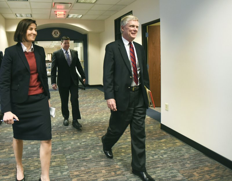 From left, Assistant Attorney General Christina Grossi, Special Agent David Dwyre, and Special Prosecutor Bill Forsyth head in for a press conference, Friday, Dec. (Matthew Dae Smith/Lansing State Journal via AP)