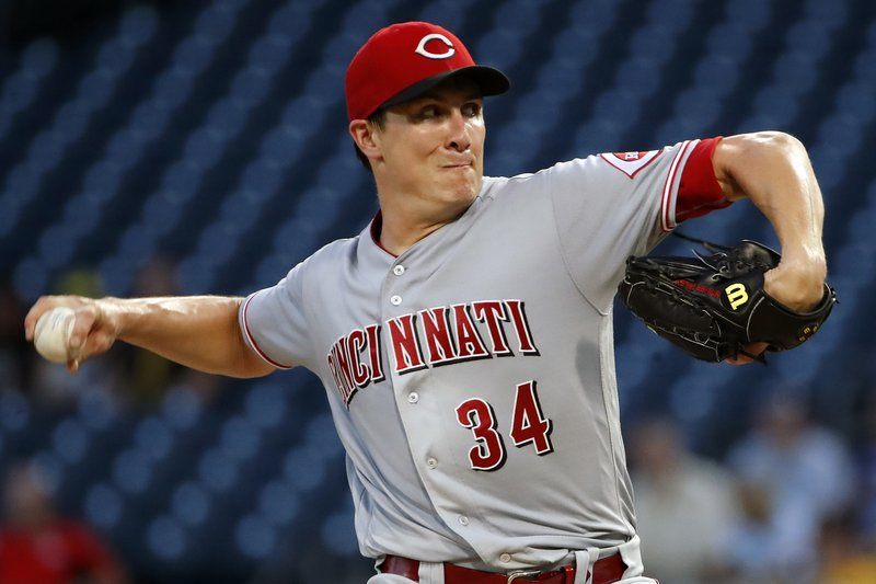 FILE - In this Sept. 5, 2018, file photo, Cincinnati Reds starting pitcher Homer Bailey delivers in the first inning of the team's baseball game against the Pittsburgh Pirates in Pittsburgh. (AP Photo/Gene J. Puskar)
