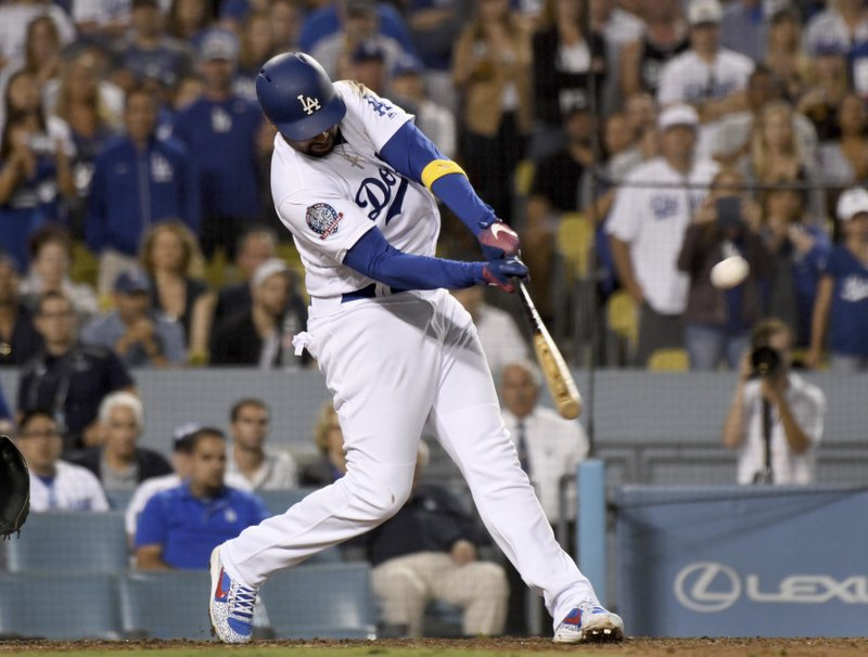 FILE -In this Sept. 1, 2018, file photo, Los Angeles Dodgers' Matt Kemp hits a three-run home run in the eighth inning of a baseball game against the Arizona Diamondbacks in Los Angeles. (AP Photo/Michael Owen Baker, File)