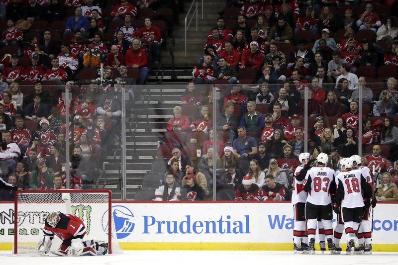 Ottawa Senators, right, celebrate a goal by Matt Duchene as New Jersey Devils goaltender Keith Kinkaid is slow to get u during the second period of an NHL hockey game Friday, Dec. (AP Photo/Julio Cortez)