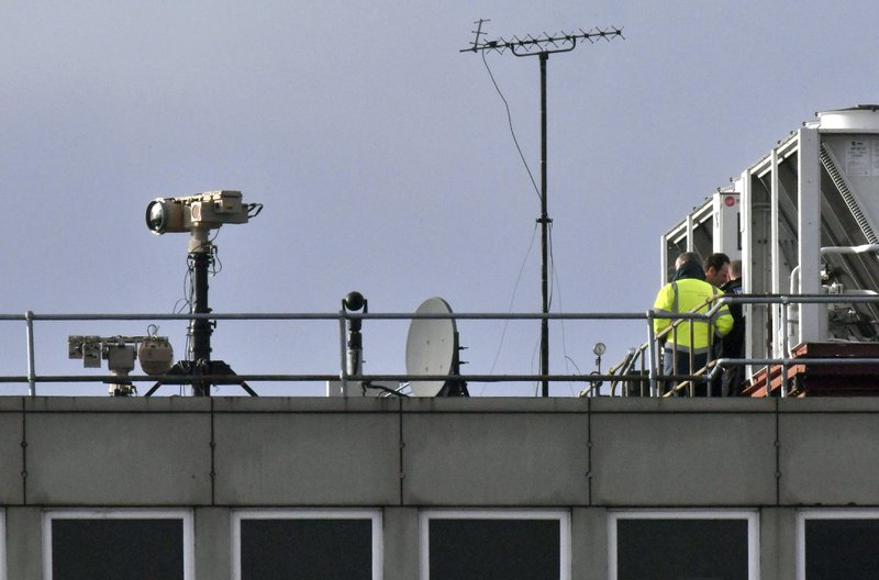 Counter drone equipment is deployed on a rooftop at Gatwick airport in Gatwick, England, Friday, Dec. (John Stillwell/PA via AP)