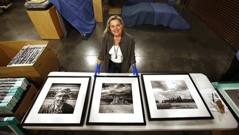 Alison Goldwater Ross, the granddaughter of former Arizona Sen. Barry Goldwater who is trying to save and digitize her grandfather's photographic archive, poses for a photograph as she unpacks some of her grandfather's framed photographic work at Scottsdale's Museum of the West Thursday, Dec. (AP Photo/Ross D. Franklin)