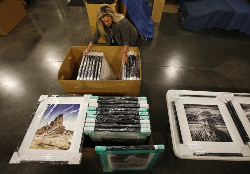 Alison Goldwater Ross, the granddaughter of former Arizona Sen. Barry Goldwater who is trying to save and digitize her grandfather's photographic archive, unpacks some of her grandfather's framed photographic work at Scottsdale's Museum of the West Thursday, Dec. (AP Photo/Ross D. Franklin)