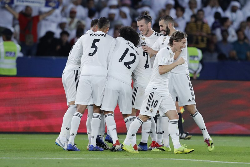 Real Madrid's players celebrate after scoring during the Club World Cup final soccer match between Real Madrid and Al Ain at Zayed Sport City in Abu Dhabi, United Arab Emirates, Saturday, Dec. (AP Photo/Hassan Ammar)