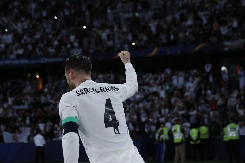 Real Madrid's defender Sergio Ramos celebrates after scoring during the Club World Cup final soccer match between Real Madrid and Al Ain at Zayed Sport City in Abu Dhabi, United Arab Emirates, Saturday, Dec. (AP Photo/Hassan Ammar)