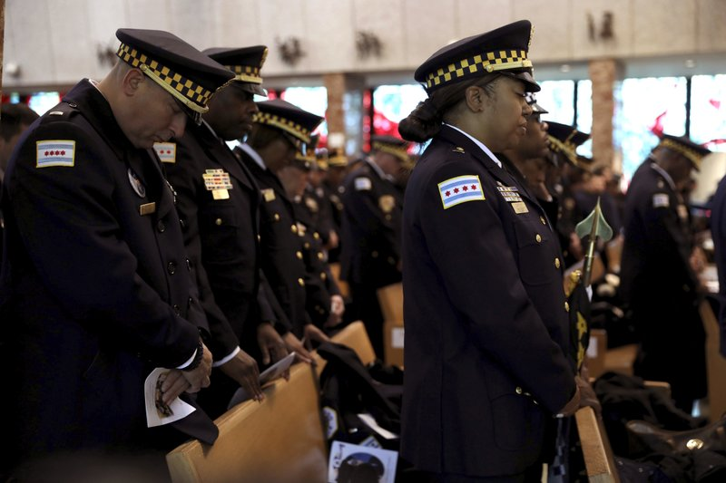 Chicago police officers attend funeral for fallen Chicago police Officer Eduardo Marmolejo at St. Rita of Cascia Shrine Chapel in Chicago on Saturday, Dec. (Abel Uribe/Chicago Tribune via AP, Pool)