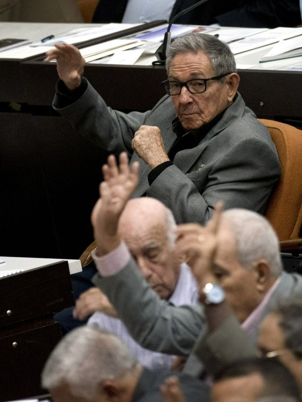 Cuba's former President Raul Castro, center, votes during a session to debate the draft of a new Constitution, at the Convention Palace in Havana, Cuba, Friday, Dec. (AP Photo/Ramon Espinosa)