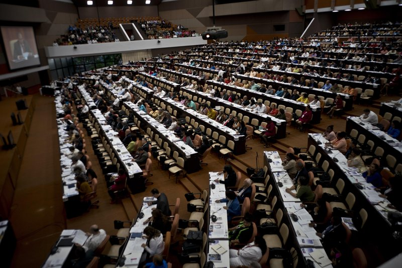 Members of the National Assembly attend a session to debate the draft of a new Constitution, at the Convention Palace in Havana, Cuba, Friday, Dec. (AP Photo/Ramon Espinosa)