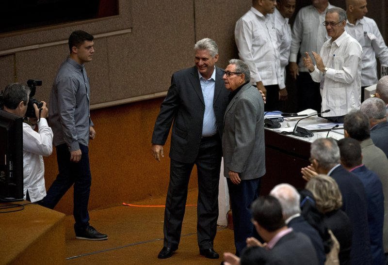 Cuba's President Miguel Diaz-Canel and former president Raul Castro, pose for a photo before the start of a session to debate the draft of a new Constitution, at the Convention Palace in Havana, Cuba, Friday, Dec. (AP Photo/Ramon Espinosa)
