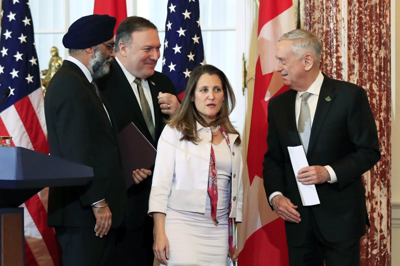 Secretary of State Mike Pompeo, second from left, and Defense Secretary Jim Mattis right, and their Canadian counterparts Canadian Minister of Foreign Affairs Chrystia Freeland, second from right, and Canadian Minister of Defense Harjit Sajjan, left, leave the Benjamin Franklin Room as they conclude their news conference following a U. (AP Photo/Manuel Balce Ceneta)