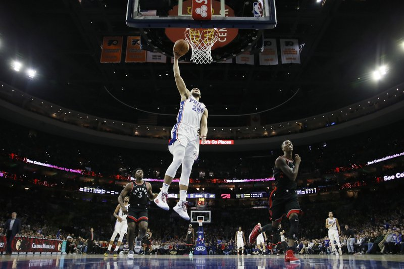 Philadelphia 76ers' Ben Simmons goes up for a dunk during the first half of an NBA basketball game against the Toronto Raptors, Saturday, Dec. (AP Photo/Matt Slocum)