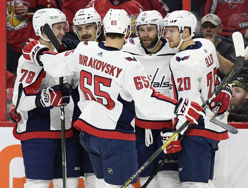 Washington Capitals right wing Brett Connolly (10) celebrates his goal against the Ottawa Senators with teammates during the first period of an NHL hockey game, Saturday, Dec. (Justin Tang/The Canadian Press via AP)