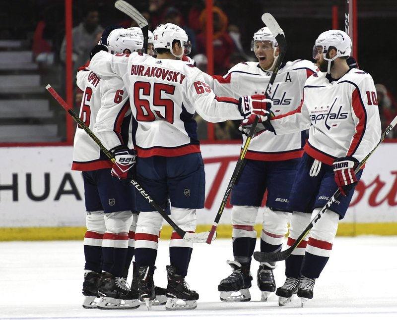 Washington Capitals players celebrate the goal of defenseman Michal Kempny (6) against the Ottawa Senators during the second period of an NHL hockey game, Saturday, Dec. (Justin Tang/The Canadian Press via AP)