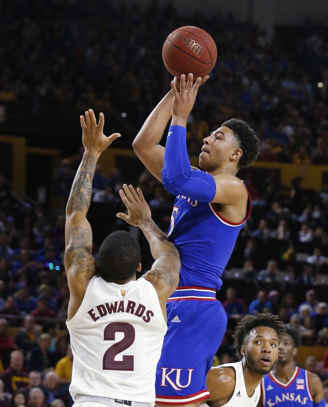 Kansas guard Quentin Grimes (5) shoots over Arizona State guard Rob Edwards during the first half of an NCAA college basketball game Saturday, Dec. (AP Photo/Rick Scuteri)