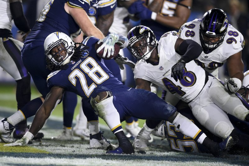 Los Angeles Chargers running back Melvin Gordon scores against the Baltimore Ravens during the second half in an NFL football game Saturday, Dec. (AP Photo/Kelvin Kuo)
