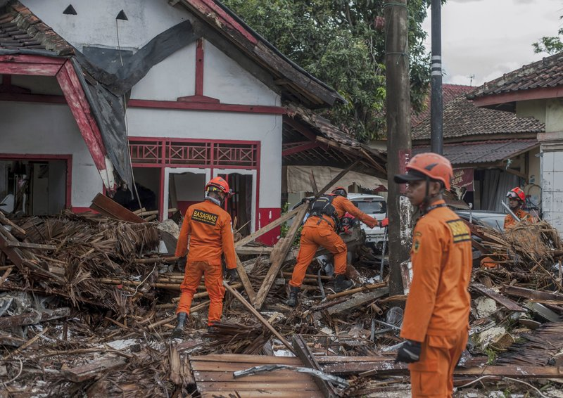 Rescuers search for tsunami victims in Carita, Indonesia, Sunday, Dec. 23, 2018. The tsunami occurred after the eruption of a volcano around Indonesia's Sunda Strait during a busy holiday weekend, sending water crashing ashore and sweeping away hotels, hundreds of houses and people attending a beach concert. (AP Photo/Fauzy Chaniago)