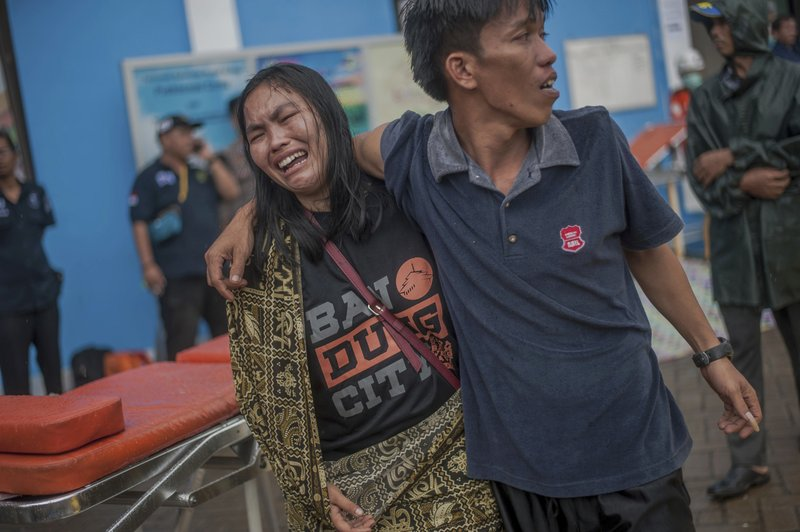 A woman reacts after identifying a relative among the bodies of tsunami victims in Carita, Indonesia, Sunday, Dec. (AP Photo/Fauzy Chaniago)