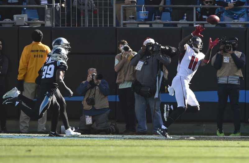 Atlanta Falcons' Julio Jones (11) catches a touchdown pass past Carolina Panthers' Mike Adams (29) during the first half of an NFL football game in Charlotte, N. (AP Photo/Mike McCarn)