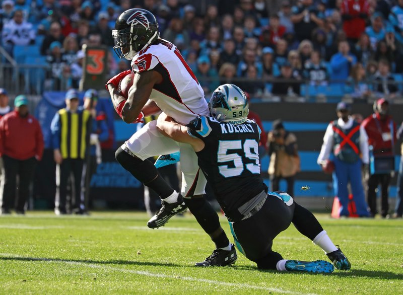 Atlanta Falcons' Julio Jones (11) is tackled by Carolina Panthers' Luke Kuechly (59) during the first half of an NFL football game in Charlotte, N. (AP Photo/Jason E. Miczek)
