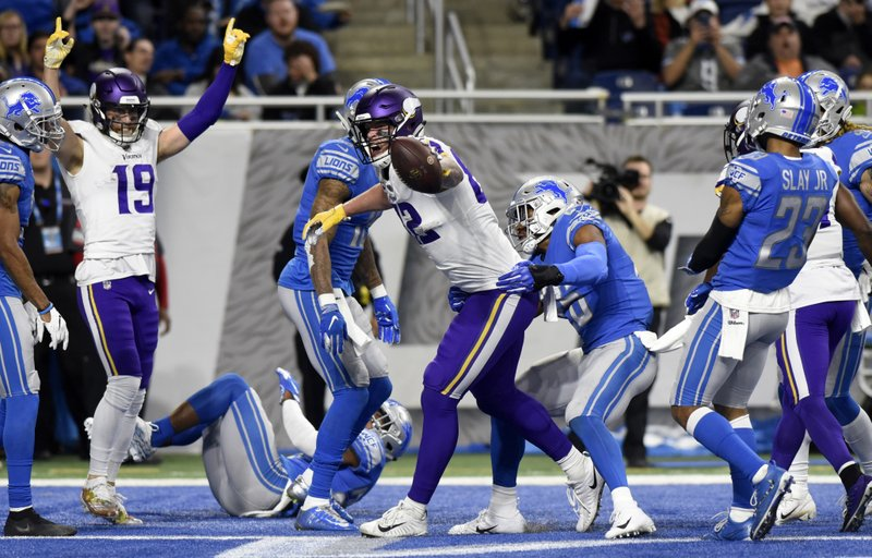 Minnesota Vikings tight end Kyle Rudolph reacts after his 44-yard reception for a touchdown during the first half of an NFL football game, against the Detroit Lions Sunday, Dec. (AP Photo/Jose Juarez)