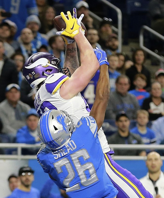 Minnesota Vikings tight end Kyle Rudolph, defended by Detroit Lions defensive back DeShawn Shead (26), catches a 44-yard pass for a touchdown with no time on the clock during the first half of an NFL football game, Sunday, Dec. (AP Photo/Rey Del Rio)