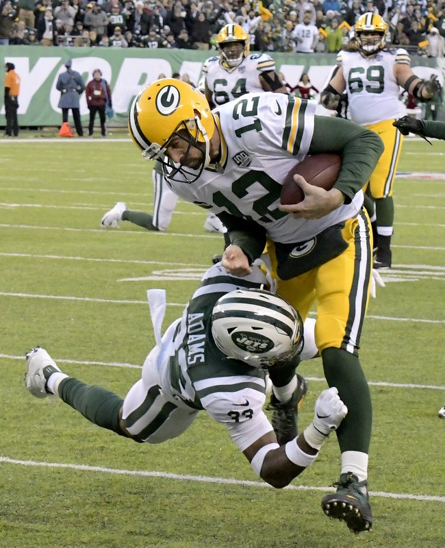Green Bay Packers quarterback Aaron Rodgers (12) is tackled by New York Jets strong safety Jamal Adams (33) during the second half of an NFL football game, Sunday, Dec. (AP Photo/Bill Kostroun)